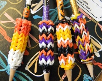 4 Removable Rainbow Loom Halloween Pencil Grips with Pencils - Gold, Spider Webs, Pumpkins, and Skulls