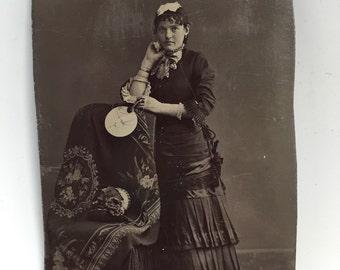 Antique tin type of women by chair 1901