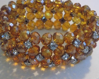 Vintage bracelet, iridescent amber orange glass crystals and clear silver backed crystals stretchy cuff bracelet