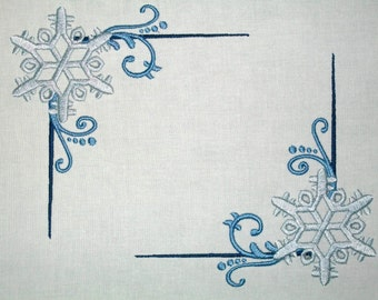 Blue snowflake swirls embroidered quilt label to customize with your personal message