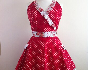 Retro apron crossed over with flared skirt, white polka dot on a red fabric. 1950s inspired.