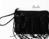 Fringe clutch pictured with Heather Storm of Garage Squad. Black sequins Design with 11 faux suede fringe. Evening bag. Bridesmaids clutc