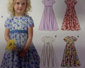 2005 Jewel Neck High Waist Flared Dress Pattern ~ McCall's 4746 Girls' Size 3-4-5-6. FLOWERGIRL DRESS PATTERN and More at WhiletheCatNaps