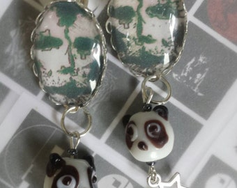 Sale was 17uk now 14uk Bauhaus (the band) Mask character with glass Pandas earrings.