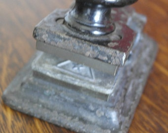 antique small iron paper press star