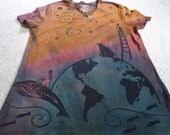 A variation on the all life matters theme, humans & animals all living together as earth swirls through space, woman's discharged t-shirt