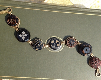 Antique Button Bracelet, Black glass, gold trim, inlay