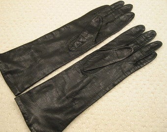 vintage 'Dawnelle' black genuine  leather gloves . . ladies size S . . mid-arm length . . gently worn . . . . nylon lined