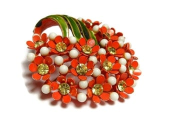 Orange bouquet brooch, vibrant floral pin of orange flowers with yellow rhinestones mixed with white beads and topped with green leaves