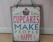 """Sign """"Cupcakes make people happy"""""""