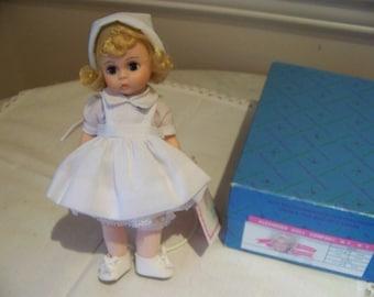 Nurse # 308 8 inch doll Madame Alexander marked RN on uniform.. also one dark haired.