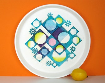 Vintage 1960s serving tray, plastic, kaleidoscope print, teal and lime, op art pattern