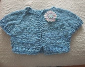 Little girl's Frozen inspired turquoise shrug with matching broach
