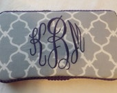 Grey quatrefoil decorated travel wipes case with purple trim and letters.Many colors and matching items available.