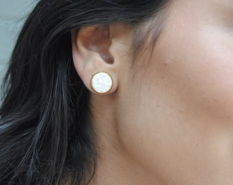 white stone stud earrings
