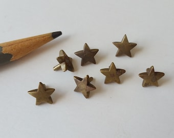7 Cast brass stars with pegs