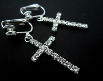 A pair of pretty rhinestone/diamante cross  dangly clip on earrings.
