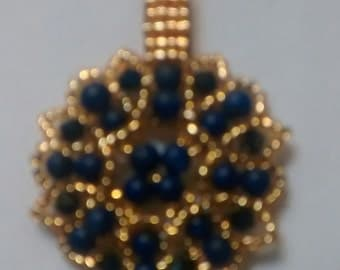 Pendant to glam up a necklace, for UofM fans.
