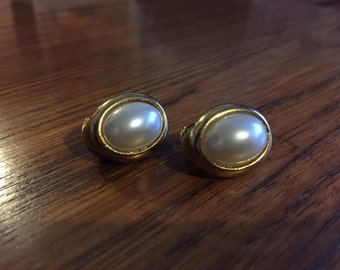 Oval gold and pearl clip on earrings.