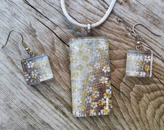 Glass pendant and earrings made with Japanese Chiyogami paper with white and gold flowers on silver and bronze background