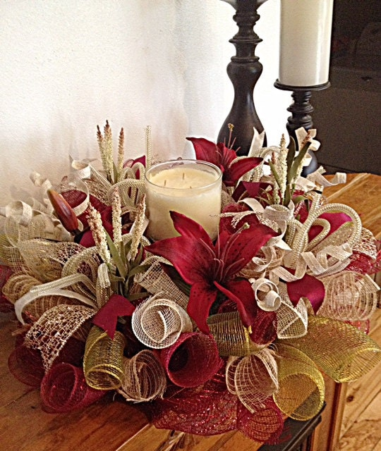Burgundy lily centerpiece moss burlap and cream