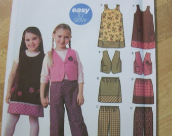 Simplicity 5489 Child's (Size A 3,4,5,6,7,8) jumper, lined vest, pants and skirt