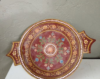 A painted wooden bowl