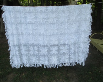 Crocheted bed spread wtih fringe