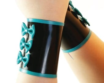 Latex Bow Cuffs - a pair