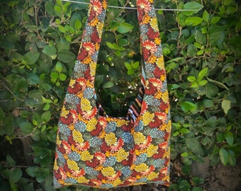 bright floral hobo bag with contrasting striped lining