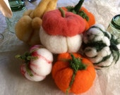 Pumpkins in carded wool, toy food for children. Waldorf style. Halloween