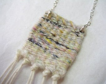 woven necklace in white pastel silver - tiny miniature weaving with silver chain, wool/silk/mohair blend, cotton tassel - wearable fiber art