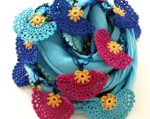 Light blue scarf with crocheted handfans