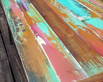 colorfully painted dining table,hand made,reclaimed, vintage door wood,, patina, pipe legs. industrial. re purposed.