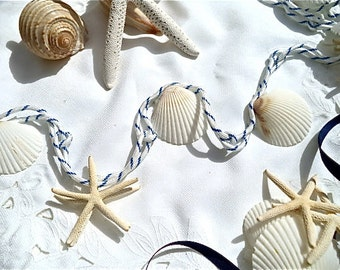 Shell Garland with Starfish - You can quickly decorate anything with this classic white and navy. Easy simple garland for a beachy look.