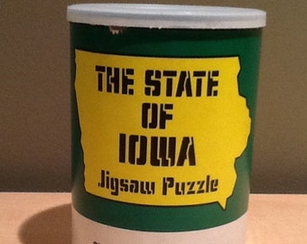 Vintage Iowa Jigsaw Puzzle from the Des Moines Register. 100 pieces and measures 13 1/4 inches by 10 inches assembled. Comes in fun cardboar