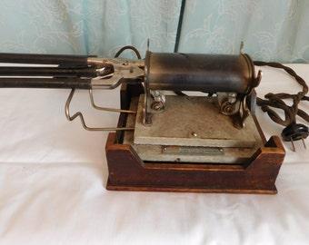 1923 Curling iron