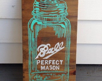Mason jar painting in reclaimed wood