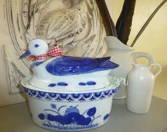 Ceramic Duck sitting on Storage Bowl