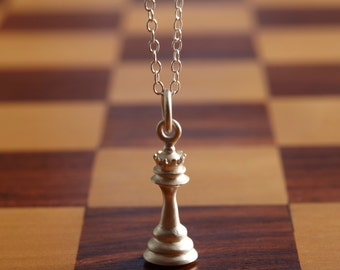Sterling Silver Chess Piece Charm Necklace. Add a letter charm, and a personal message to the presentation message card.