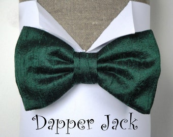 "Silk Bow Tie in British Racing Green, pre tied or self tie on an adjustable neck band, will fit neck size up to 19.5"" (48cms)"