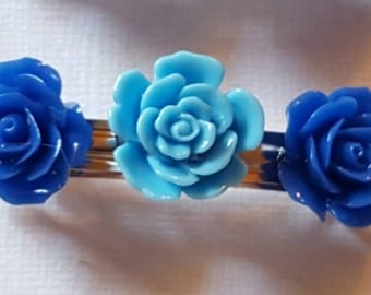 2 inch barrette with 3 resin flowers, 2 brilliant royal blue hugging 2 sky blue flowers. Buy 1 or a set of 2!