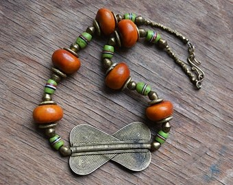 African amber necklace with Baule double heart and antique Venetian fancy beads, trade bead necklace