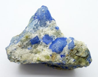 Nosean in Sodalite on Nepheline Crystals