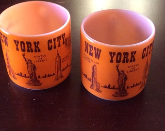 Two vintage souvenir coffee mugs with New York sites