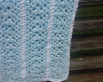 50 x 76 varigated blue with white trim crocheted blanket