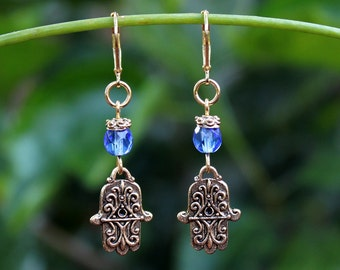 Hamsa Dangle earrings.Blue Crystal.Protection. Metal plated in 24 karat gold. Drop Earrings.Judaica.Hanukkah. Bat-Mitzvah.Gift. Handmade.