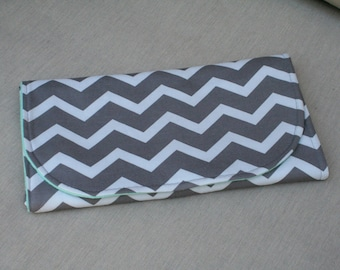 All-in-One Diaper Clutch with Built in Changing Pad - Travel clutch and changing pad-Grey and White Chevron with Blue Lining