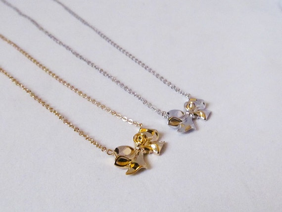 Bow necklace jewelry meaning twixt designs you might also like aloadofball Choice Image