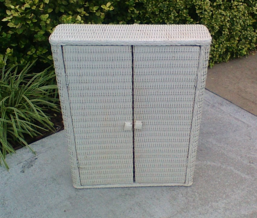 white or cream wicker or rattan bathroom or kitchen storage cabinet